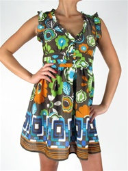 Fun patterns, colors and trim make this Mod Dress and Must Have!