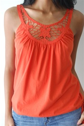 A lace tooled tank.